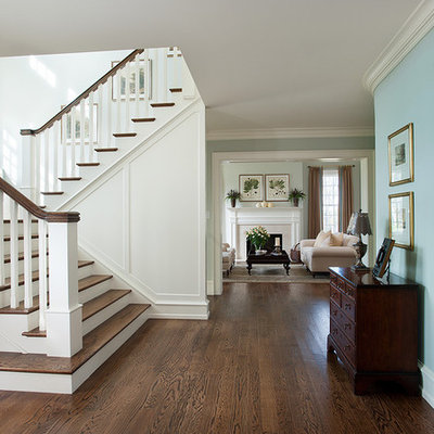 Example of a classic wooden u-shaped wood railing staircase design in Philadelphia with painted risers