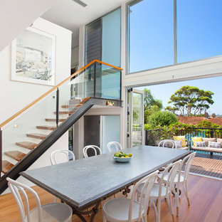 Design ideas for a contemporary wood straight staircase in Sydney with open risers and glass railing.