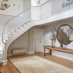 Photo Of A Clic Painted Wood L Shaped Staircase In London With Risers