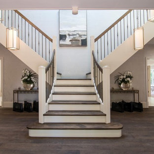 Inspiration for a medium sized and mixed traditional wood staircase in Other with painted wood risers.