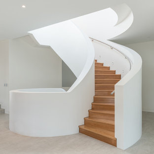 Design ideas for a large contemporary wood curved staircase in Sydney with wood risers.