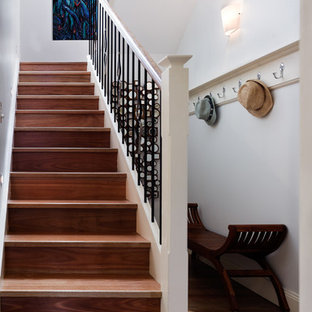 Inspiration for a mid-sized contemporary wooden u-shaped staircase remodel in Sydney with wooden risers