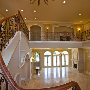 Staircase - traditional painted spiral staircase idea in Miami with metal risers