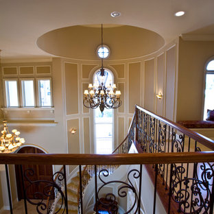 Inspiration for a timeless painted spiral staircase remodel in Miami with metal risers