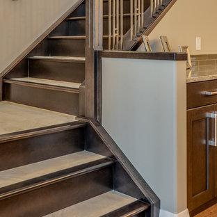 Foto de escalera en L, clásica renovada, de tamaño medio, con escalones con baldosas y contrahuellas de madera