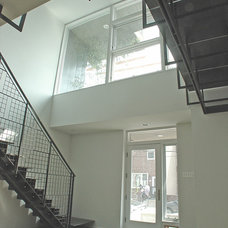 Modern Staircase by Bright Common Architecture & Design