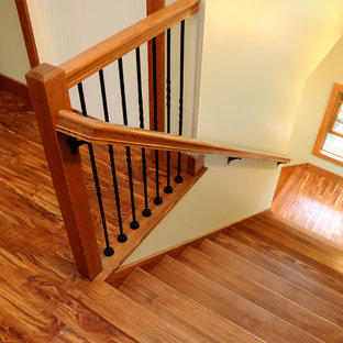 Medium sized classic wood l-shaped staircase in Other with wood risers.