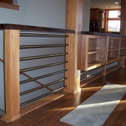 Railings - www.ArchEle.com, (360)-746-8205, This patinated round rod railing has an integral bookcase.