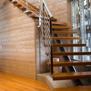 Rammed Earth.  Steel & Timber Staircase.  Custom Staircase