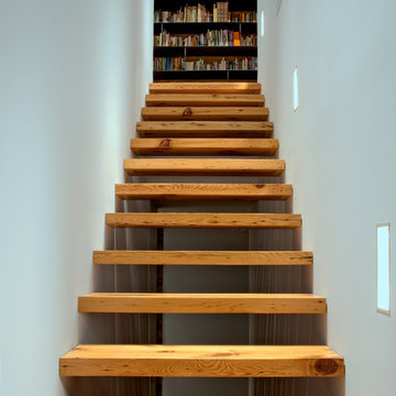 Rear stair to the second floor.