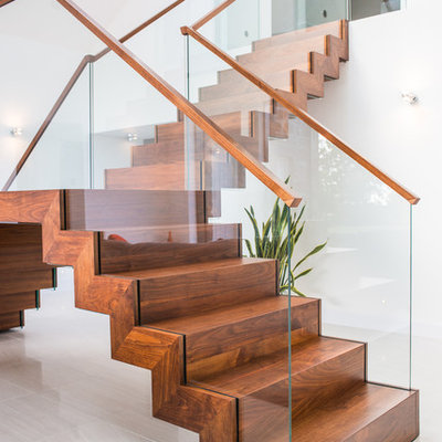 Inspiration for a contemporary wooden l-shaped staircase remodel in Other with wooden risers