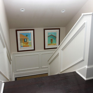 Example of a mid-sized classic wooden u-shaped wood railing staircase design in New York with wooden risers
