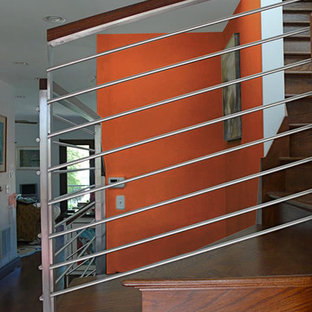 Mid-sized minimalist wooden l-shaped staircase photo in Chicago with wooden risers