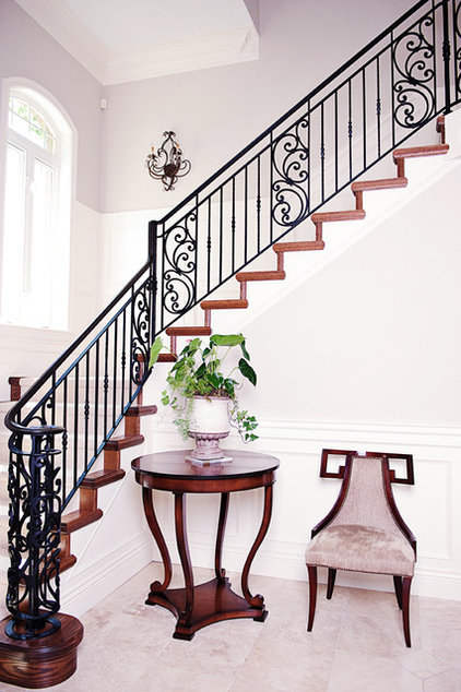 Traditional Staircase by Blue Garnet Design/The Design Mill