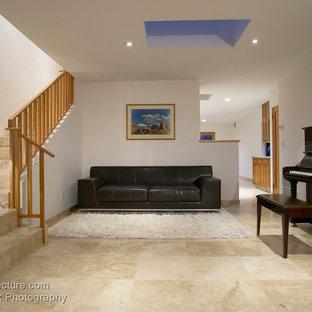Foto de escalera en L, actual, con escalones con baldosas y contrahuellas con baldosas y/o azulejos
