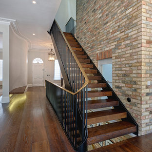 Photo of a classic wood staircase in London with open risers.