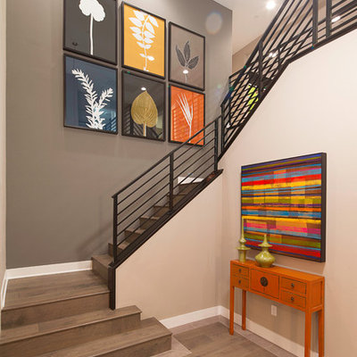 Staircase - mid-sized contemporary wooden l-shaped metal railing staircase idea in Los Angeles with wooden risers