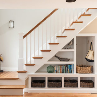 Staircase - coastal wooden staircase idea in Boston with painted risers