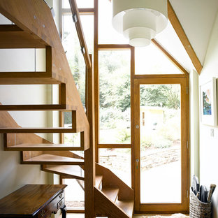 Contemporary wood l-shaped wood railing staircase in Surrey with open risers.