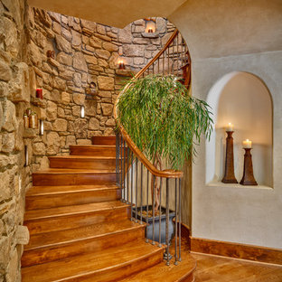 Inspiration for a mediterranean spiral staircase remodel in Other
