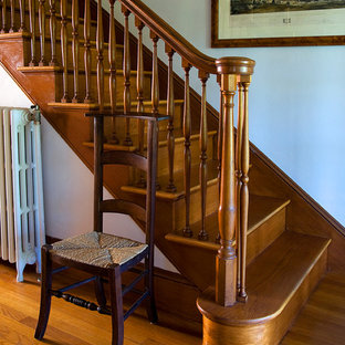 Example Of A Clic Wooden Staircase Design In Boston With Risers