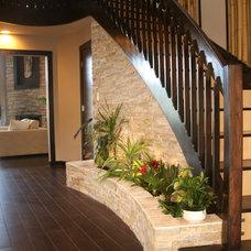 Contemporary Staircase by MNM Design Studio, Inc.
