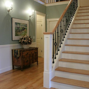 Example of a mid-sized arts and crafts wooden straight staircase design in Seattle with wooden risers