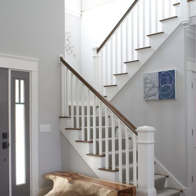 Example of a large beach style wooden u-shaped staircase design in Providence with painted risers