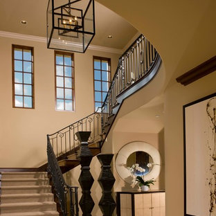 Staircase - large mediterranean carpeted u-shaped metal railing staircase idea in San Diego with carpeted risers