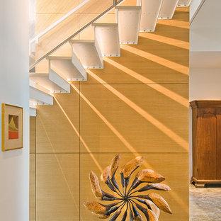 Foto de escalera recta, clásica renovada, grande, con escalones de vidrio y contrahuellas de vidrio