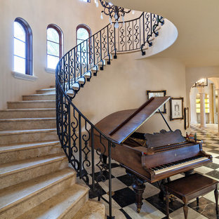 Tuscan marble curved metal railing staircase photo in Miami with marble risers