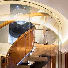 Modern Staircase by Robert J Erdmann Design, LLC