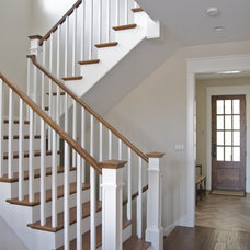 Traditional Staircase by Century Bay Builders
