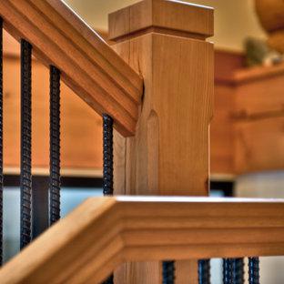 Mittelgroße Rustikale Holztreppe in L-Form mit offenen Setzstufen und Stahlgeländer in Vancouver