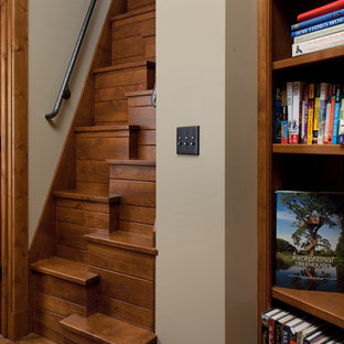 Inspiration for a small timeless wooden straight staircase remodel in Grand Rapids