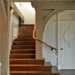 Staircase - coastal wooden staircase idea in Boston with wooden risers