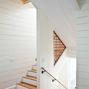 Staircase - large beach style wooden u-shaped metal railing staircase idea in Other with wooden risers
