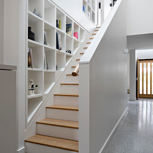 Mid-sized contemporary wood straight staircase in Melbourne.