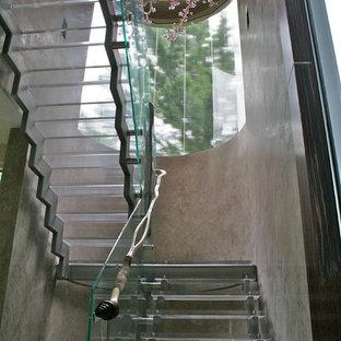 Imagen de escalera en L, moderna, sin contrahuella, con escalones de acrílico