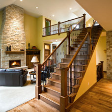 Eclectic Staircase by Gryboski Builders Inc.