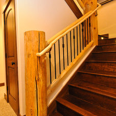 Rustic Staircase by Mountain Log Homes & Interiors