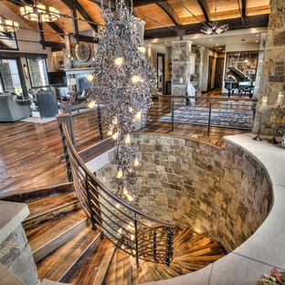 Huge Mountain Style Wooden Spiral Staircase Photo In Denver