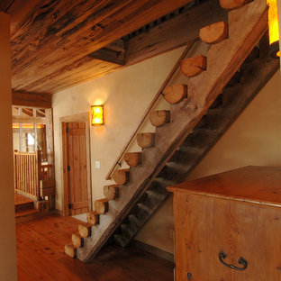 Design ideas for a rustic wood straight staircase in Other with wood risers.
