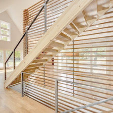 Contemporary Staircase by Lake Country Builders