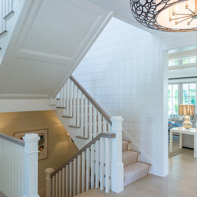 Staircase - large country wooden u-shaped wood railing staircase idea in New York with painted risers