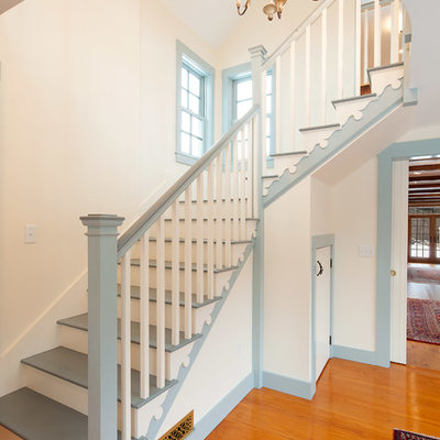 Large farmhouse painted l-shaped staircase photo in Boston with painted risers