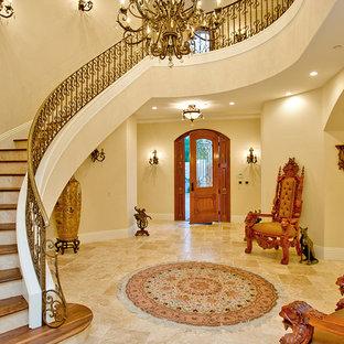 Foto de escalera curva, campestre, con escalones de madera y contrahuellas con baldosas y/o azulejos