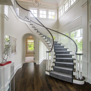 Example of a transitional wooden curved wood railing staircase design in Chicago with wooden risers
