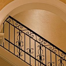 Mediterranean Staircase by Gelotte Hommas Architecture