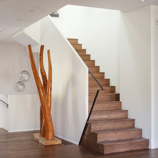 Example of a mid-sized trendy wooden l-shaped metal railing staircase design in Other